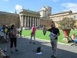 Our tour guide explaining the Sistine Chapel before we went inside , Pamela R - August 2015