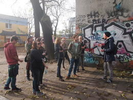 Guide leading us through an abandoned train yard now filled with art, Rachel - November 2013