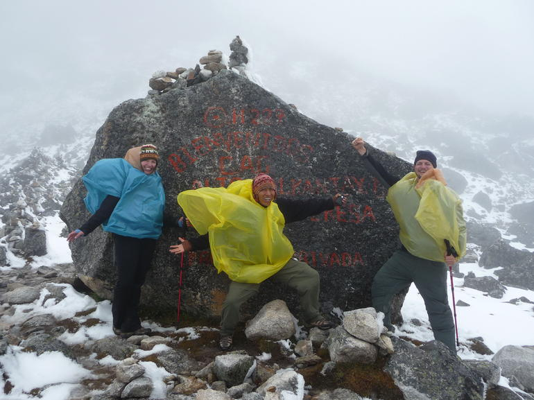 Photo op at the top of the pass with our awesome guide - Cusco