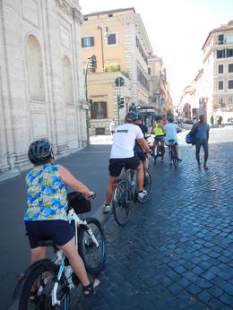 Single file line of bikes in our tour through the streets of Rome , David M - August 2017