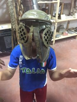 Younger son donning a replica of a gladiator mask during the overview. , debbie.cifone - June 2017