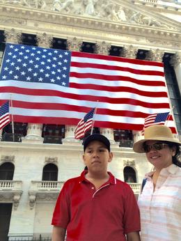My wife and son in front of the New York Stock Exchange Building on 9/4/2016. The big USA flag is posted only on holy days. , Denis M R - September 2016