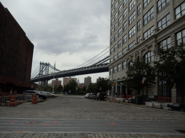 Manhattan Bridge with the Empire State Building in the background - New York City