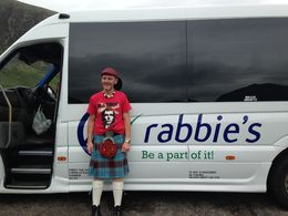 Ally from the Rabbie's tour company in front of the tour bus , Katya I - July 2016
