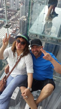 My husband and I, enjoying the beautiful view of the city of Chicago, from the 101 floor of the Willis Tower. , Nora R - August 2016