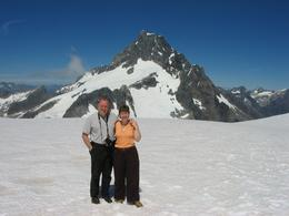 Will & Lynne Andrews standing amazed at the beauty of the 'snow landing' on the return trip. Seeing Milford Sound was great, but this was more amazing!, William A - February 2009