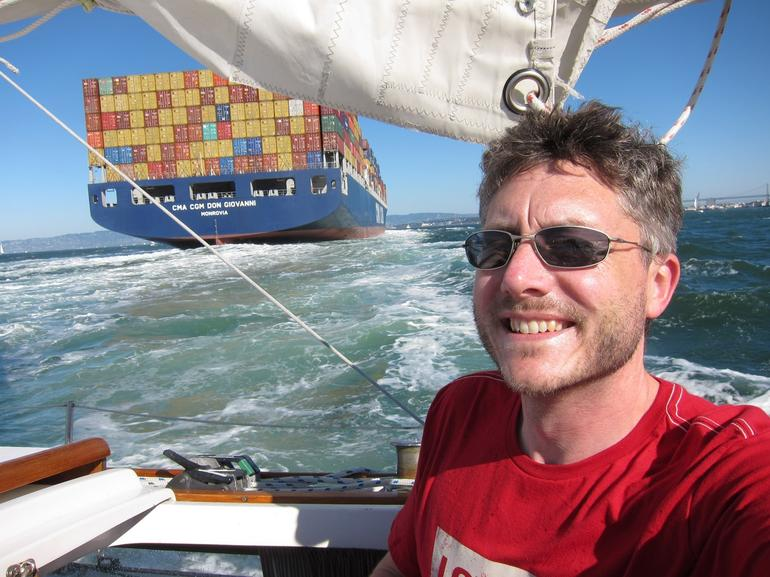This is me as we pass behind a big container ship -