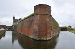 through the gate and out first open view of the imposing walls and moat of Kronborg Castle mad famous in Shakespear's Hamlet. , Richard H - September 2015