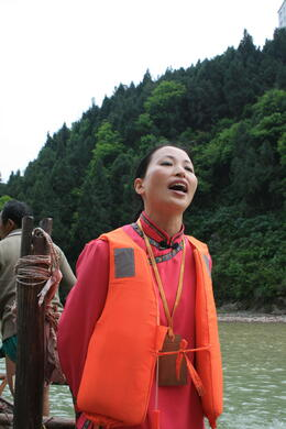 Our Tujia minority guide signing a local song for us during our excursion to Shennong Stream....She was amazing!, Bing - May 2012