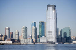 From the Hudson River, one can see tall city buildings from downtown Manhattan. , Armenta Y - January 2015
