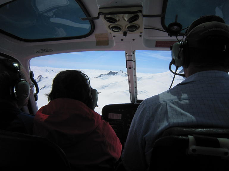 the view from our seat, mostly of the people in the front row and the pilot - Franz Josef & Fox Glacier