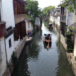 Taking a gondola along a canal in Zhouzhuang , Kathy B - August 2016