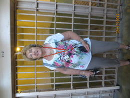 Marg standing outside the cell. Would rather be out than in . , Peter C - October 2014