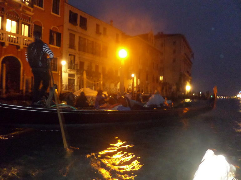 Evening on the Grand Canal, with a traditional Gondolier Serenade.Venice - Venice