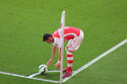 Ozil preparing to take a corner, Bandit - May 2015
