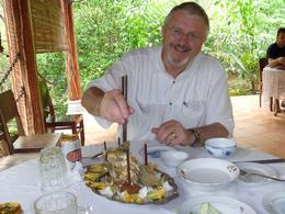Lunch on the island part of the tour, the remains of the Elephant ear fish being attacked by Gary, Bernadette J - June 2010