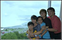 My family at our hotel room facing the magnificent Niagara Horse Shoe Falls , LUDWIG G - August 2012