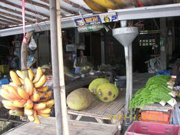 Here's a pic of one vendor stall at the local market. , Linda D - July 2013