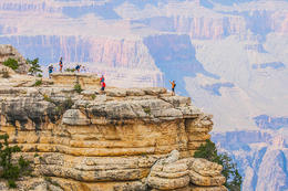 Tourist posing for photos on the South Rim of the Grand Canyon., Viator Insider - December 2017