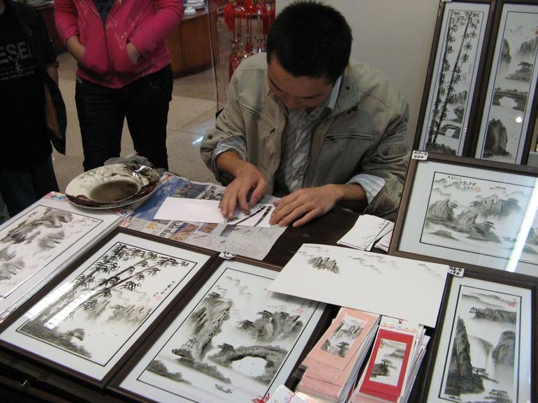 Artist fingerpainting - Hong Kong