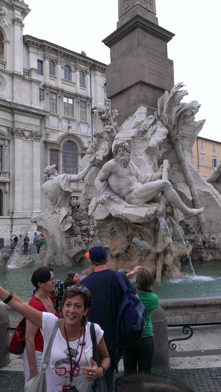 Our tour guide Arianna in front of Fontana dei quattro fiumi - Rome