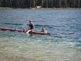 Not possible for 3 people to stand up at once. Pretty hard to paddle like a kayak too. Try it for yourself! , Sarah W - September 2012