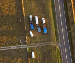 "Looking down, we can see our ""chase"" vehicles, aka ground crew, anxiously anticipating our arrival. - March 2010"