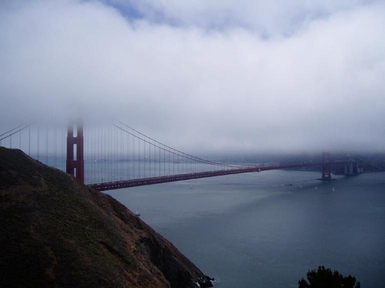 Golden Gate bridge shrouded in fog - San Francisco