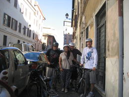 all four of us excited to ride around Rome!! at the bike shop , artist4rags - October 2012