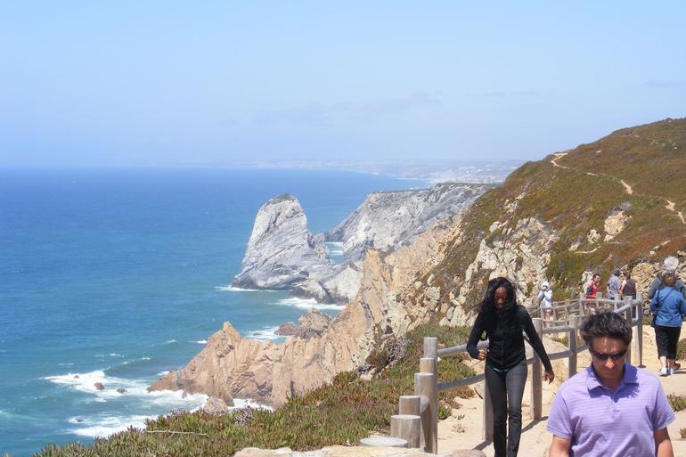 Walking along Estoril coastal trail, in the region of Sintra - Lisbon