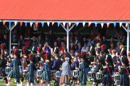 Bagpipe bands marching past the audience stands during the annual Highland Games at Braemar, Scotland on September 7, 2013. , Julie G - September 2013