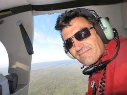 Enjoying his open door volcano helicopter ride!, Patricia P - December 2014