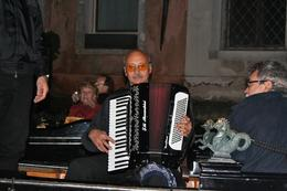 This was our travelling music as we floated through the canals of Venice. It was dark, so it was difficult to get good pictures, but the reflections of lights off the canal at night were spectacular., Jill M - October 2010
