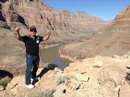 My husband striking a handsome thumbs up pose in front of the Colorado river 3200 feet into the Grand Canyon.... , GEORGIA PETINOU T - November 2013