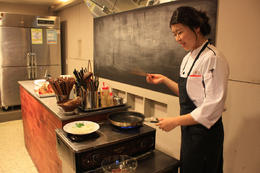 Our instructor, Hyejin, demonstrates how to cook bulgogi during the cooking class. - January 2013