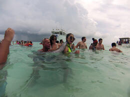 With our host who is letting the stingrays give us a back massage , versasaurus - September 2014