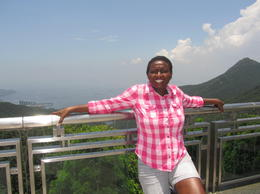 I am at the victoria peak on one of the viewing decks. , Dzidzai G - July 2014