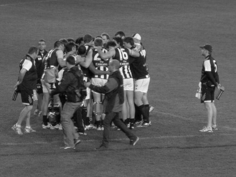 Quarter time huddle. - Melbourne