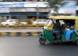 On the move - A motorized rickshaw zips through the streets of Delhi, India - November 2011