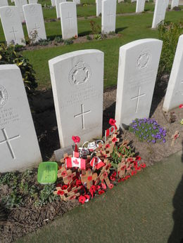 A picture of the grave of the youngest lad apparently killed in battle, he used his mothers maiden name to enlist :- , KATIE T - April 2015
