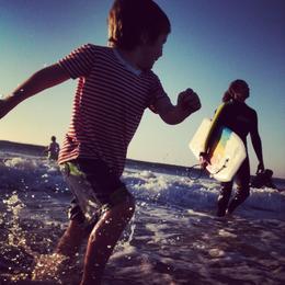 Happy kid in the waves , Skootre - December 2011