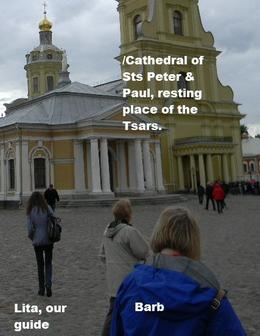 Our tiny guide - Lita - going ahead of us to get tickets to the Cathedral of Sts. Peter and Paul, the burial place of all the Tsars, from Peter the Great, on. Peter began St. Petersburg here, in..., John L S - July 2014