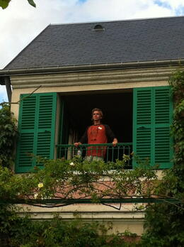 Elliot is soaking in the view from Monet's bedroom window. Truly inspiring! , Denise H - September 2013