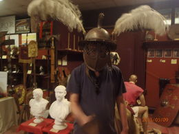 My husband Steve trying on a Thracian gladiator helmet in the museum and yes I'm assured the feathers were part of it. , Stacey E - June 2015