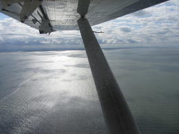 We took this photo out of the left side of the seaplane showing the sun reflecting on the water. , S H - August 2013