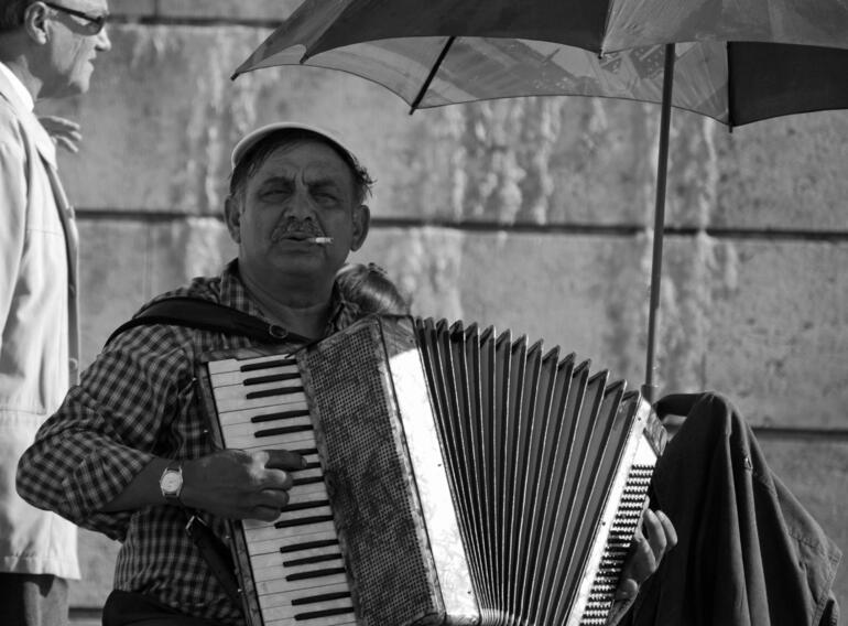 Accordian Player on the Seine - Paris, September 2009 -