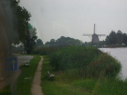This is one of the iconic windmills that one sees dotted around the countryside of the Netherlands. This one is on the banks of the River Amstel, from which the city of Amsterdam gets its name. It..., ANDY O - August 2011