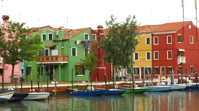 Colourful fishing village of Burano as you enter port - Venice