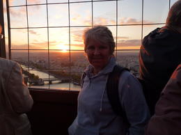 Lyn Humphries marveling at the awesome sunset from the top of the Eiffel Tower. A special moment. , Lyn H - January 2012
