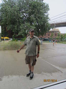 This is the guide, Isaac, under the Brooklyn Bridge near the carousel. , Annette B - July 2014